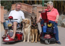 Happy Tails Service Dogs with their owners